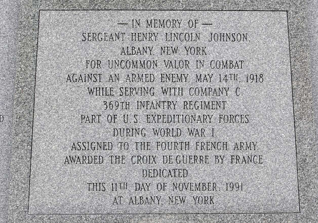 Close up of one of the script panels on The Battle of Henry Johnson statue in Washington Park Thursday, Oct. 4, 2012 in Albany, N.Y. World War I hero Sgt. Henry Johnson of Albany, subject of a 94-year effort by supporters to award him the Medal of Honor, will be featured in an hourlong episode of the PBS program ?History Detectives.? (Lori Van Buren / Times Union) Photo: Lori Van Buren / 00019541A
