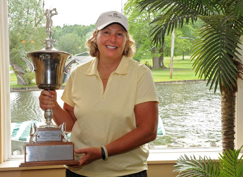 Karen Feldman from Olde Kinderhook Golf Club holds the Northeastern Women's Golf Association winners trophy in the clubhouse at Western Turnpike Golf Club on Monday, Aug. 13, 2012 in Guilderland, N.Y. (Lori Van Buren / Times Union) Photo: Lori Van Buren / 00017619A