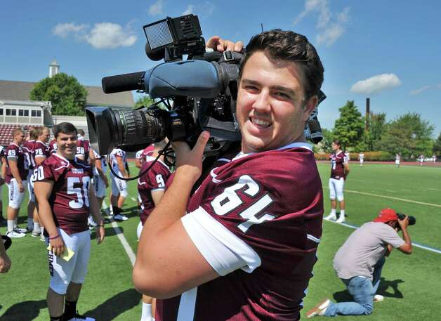 Union's #64 Anthony Vitiello borrows a television camera from a reporter during Union College Football media day Tuesday August 26, 2014, in Schenectady, NY.  (John Carl D'Annibale / Times Union) Photo: John Carl D'Annibale / 00028248A