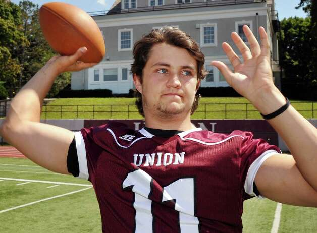 Union quarterback Connor Eck tosses the ball during Union College Football media day Tuesday August 26, 2014, in Schenectady, NY.  (John Carl D'Annibale / Times Union) Photo: John Carl D'Annibale / 00028248A