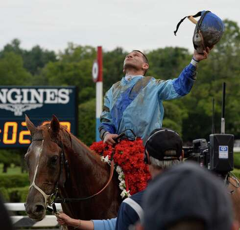 V.E. Day with a very happy jockey Javier Castellano stands prepares to enter the winner's circle Saturday afternoon Aug. 23, 2014, after winning the 145th running of the Travers at the Saratoga Race Course in Saratoga Springs, N.Y.       (Skip Dickstein/Times Union) Photo: SKIP DICKSTEIN