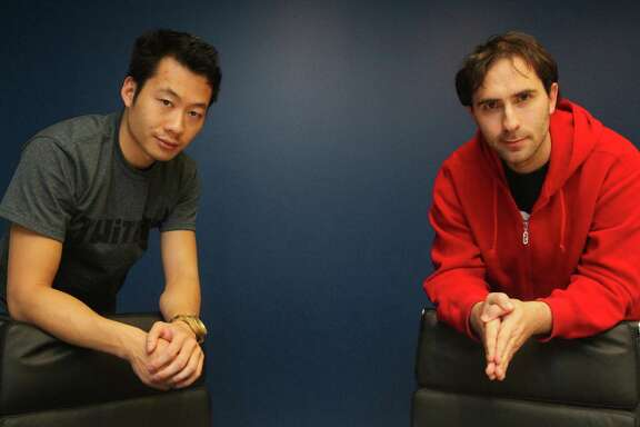 Co-founders of TwitchTV President Justin Kan, left, and CEO Emmett Shear run a company that allows people to watch others playing video games on Thursday, Dec. 15, 2011 in San Francisco, Calif.