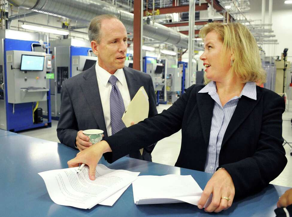 GE chief technology officer Mark Little, left, and Johanna Wellington, general manager for GE Fuel Cells at the opening of their new fuel cell facility Tuesday August 26, 2014, in Malta, NY. (John Carl D'Annibale / Times Union)