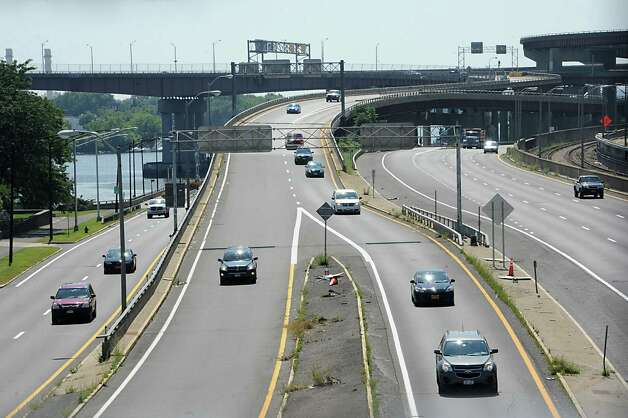 The Hudson River is seen, at left, beyond traffic on I-787 from the Hudson River Waterfront Walkway on Tuesday, Aug. 26, 2014 in Albany, N.Y. The Capital District Transportation Committee (CDTC) is undertaking a study on what to do with I-787 in downtown Albany to make the river more accessible. (Lori Van Buren / Times Union) Photo: Lori Van Buren / 00028345A