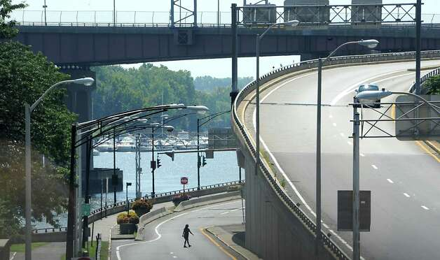 The Hudson River is seen beyond traffic on I-787 from the Hudson River Waterfront Walkway on Tuesday, Aug. 26, 2014 in Albany, N.Y. The Capital District Transportation Committee (CDTC) is undertaking a study on what to do with I-787 in downtown Albany to make the river more accessible. (Lori Van Buren / Times Union) Photo: Lori Van Buren / 00028345A