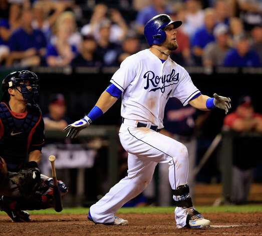 KANSAS CITY, MO - AUGUST 26:  Alex Gordon #4 of the Kansas City Royals hits a game-winning 2-run home run against the Minnesota Twins in the bottom of the 9th inning to win the game 2-1 at Kauffman Stadium on August 26, 2014 in Kansas City, Missouri.  (Photo by Jamie Squire/Getty Images) ORG XMIT: 477588733 Photo: Jamie Squire / 2014 Getty Images
