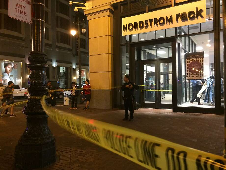 A victim suffered life-threatening injuries Tuesday night when two groups exchanged gunfire near the corner of Market Street and 5th Street in San Francisco. Photo: Kale Williams/The Chronicle