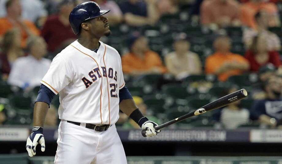 Houston's Chris Carter watches his three-run homer clear the wall during the eighth inning against Oakland. He went deep for the second straight game, increasing his season total to 32. Photo: Pat Sullivan / Associated Press / AP