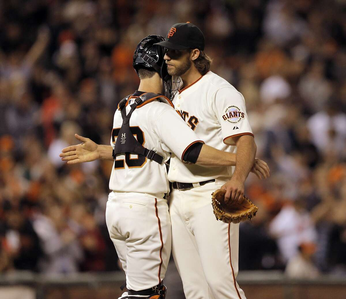 Madison Bumgarner gets a hug from catcher Buster Posey after the game and Bumgarner threw seven perfect innings as the Giants played the Colorado Rockies at AT&T Park in San Francisco, Calilf., on Tuesday, August 26, 2014.