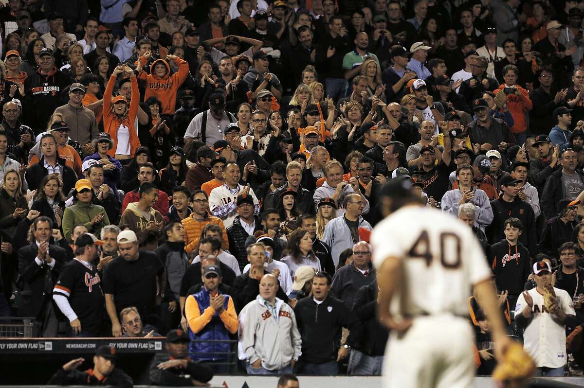 Fans cheer Madison Bumgarner as he returns to the dugout at the middle eighth inning after his perfect game was broken up by Justin Morneau as the Giants played the Colorado Rockies at AT&T Park in San Francisco, Calilf., on Tuesday, August 26, 2014.