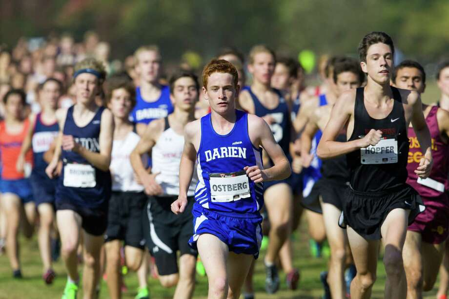 Darien's Alex Ostberg leads the pack during the 2013 FCIAC boys cross country championship at Waveny Park in New Canaan on Thursday, October 17, 2013. Photo: Contributed / Darien News Contributed