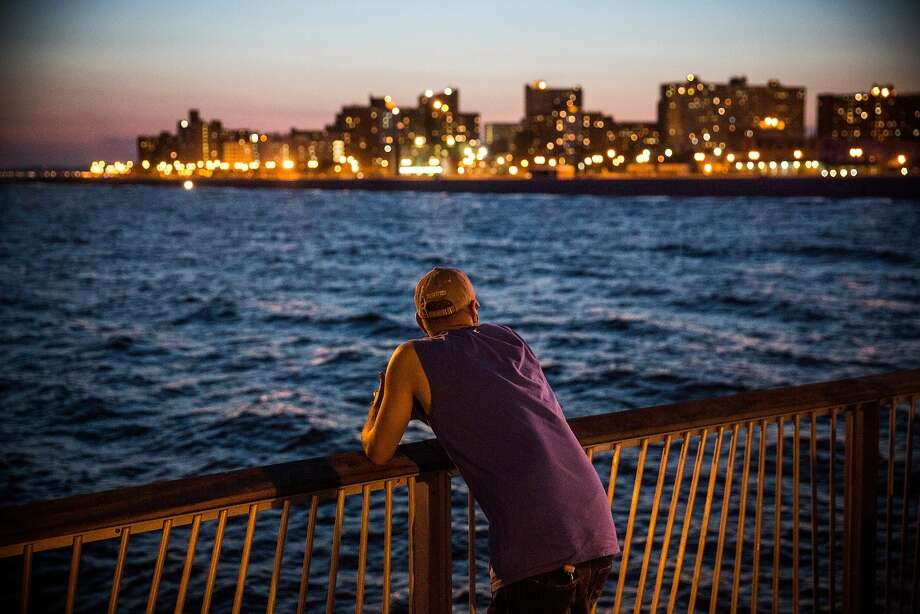NEW YORK, NY - AUGUST 26:  A man looks out from a pier on the evening of August 26, 2014 in the Coney Island neighborhood in the Brooklyn Borough of New York City. As August comes to a close, Coney Island's busiest season, summer, is beginning to wrap up.  (Photo by Andrew Burton/Getty Images) Photo: Andrew Burton, Getty Images