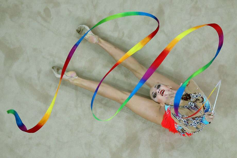 Where did it go?Irina Annenkova of Russia is a terrific performer in rhythmic gymnastics despite apparently missing an arm. (Summer Youth Olympic Games in Nanjing, China.) Photo: Feng Li, Getty Images