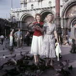 French actress Francoise Arnoul  and Italian actress Giulietta Masina posing among the pigeons in San Marco square during the 16th Venice International Film Festival. Venice, September 1955 (Photo by Mario De Biasi/Carlo BavagnoliMondadori Portfolio by Getty Images)
