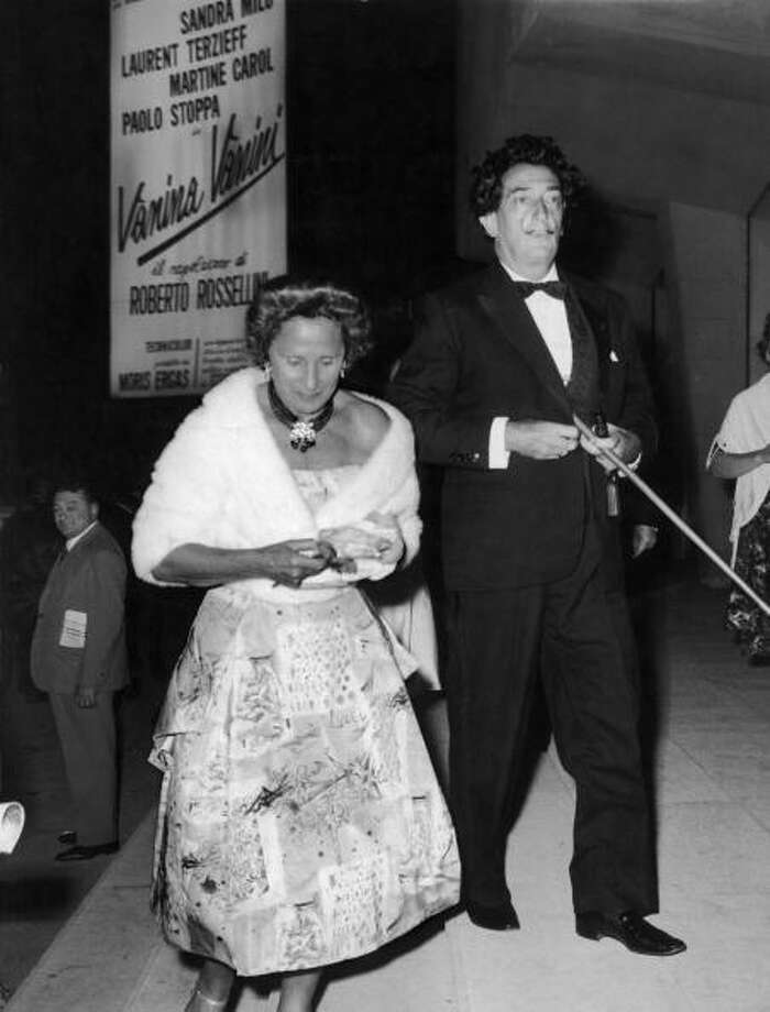 Salvador DALI, accompanied by his wife Gala, entering the screening room for the film premiere of LE GARDE DU CORPS, by the Japanese director Akira KUROSAWA, during the International Film Festival of Venice, on August 21, 1961.  (Photo by Keystone-France/Gamma-Keystone via Getty Images) Photo: Keystone-France, Gamma-Keystone Via Getty Images / 1961 Keystone-France