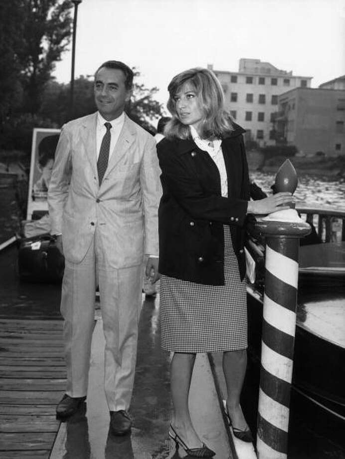 The Italian film-maker Michelangelo ANTONIONI and his wife, the Italian actress Monica VITTI in Venice where they were attending the International film festival.  1962. Photo: Keystone-France, Gamma-Keystone Via Getty Images