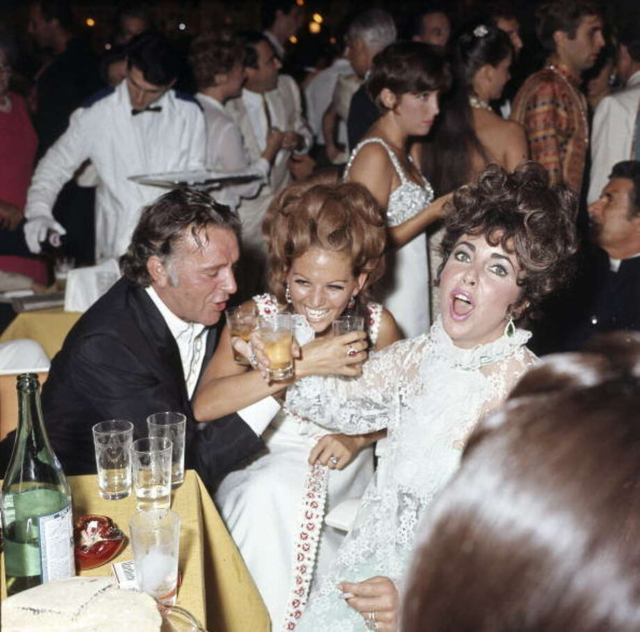 Richard Burton, Claudia Cardinale and Elizabeth Taylor yukking it up.  No matter how talented you are -- there's just nothing appealing about being a drunk.  Aren't you glad you weren't at that party? Photo: Mondadori, Mondadori Via Getty Images
