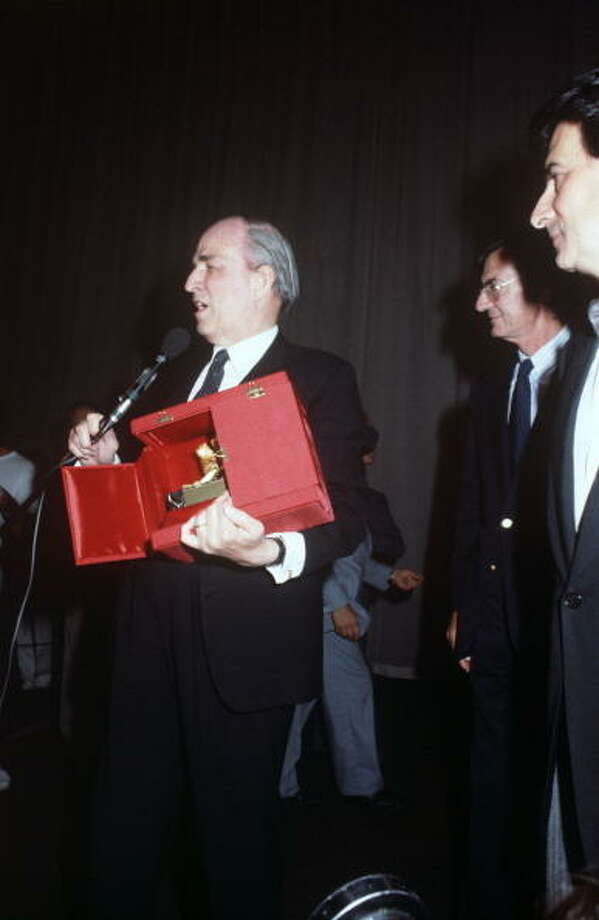 Swedish director Ingmar Bergman speaking into the microphone holding the Golden Lion for Lifetime Achievement that he won at the 40th Venice International Film Festival. Venice, 1983. Photo: Mondadori, Mondadori Via Getty Images