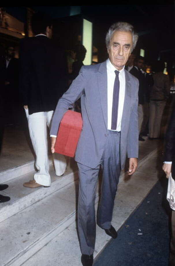 The Italian director Michelangelo Antonioni carries under his arm and closed in a box the Golden Lion lifetime achievement award, received at the 40th edition of the Venice Film Festival. Venice (Italy), September 1983.  That's what it all comes down to.  Pour everything into your work, and the best you can hope for is to wind up alone, carrying a red box and waiting for the boat to show up. Photo: Mondadori, Mondadori Via Getty Images / Mondadori Portfolio/Alberto Roveri