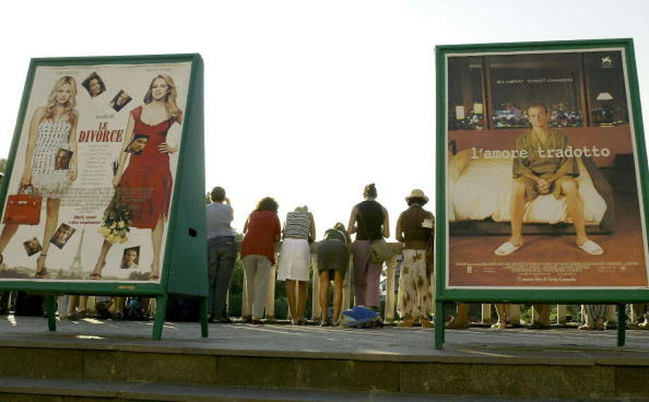 Cinema fans wait for the arrivals of actors from a balcony at Venice Lido,  26 August 2003. Photo: VINCENZO PINTO, AFP/Getty Images