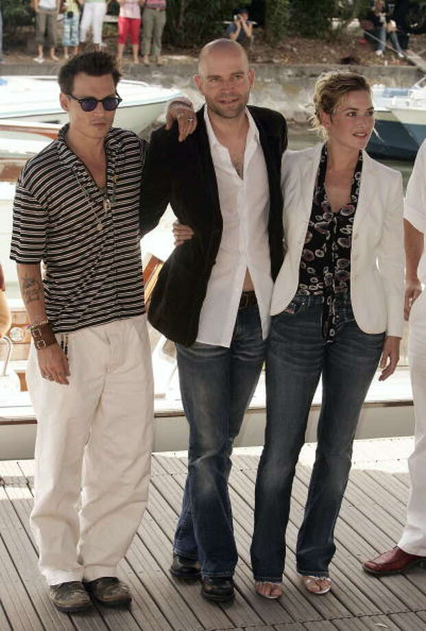 "Actor Johnny Depp, director Mark Forster and actress Kate Winslet arrive by boat for the ""Finding Neverland"" Photocall at the 61st Venice Film Festival on September 4, 2004 in Venice, Italy.  (Photo by Pascal Le Segretain/Getty Images) Photo: Pascal Le Segretain, Getty Images"