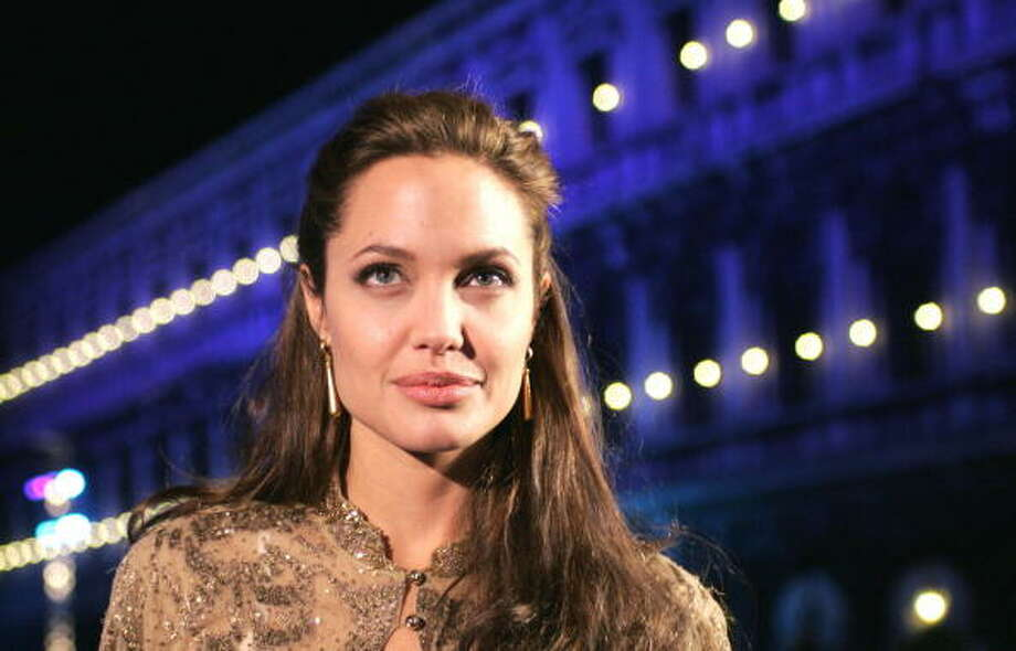 Angelina Jolie arrives in Venice St. Marco square to present the world premiere of the animation film 'Shark Tale', shown out of competition, at the 61st Venice Film Festival in Venice, 10 September 2004. Photo: STR, AFP/Getty Images