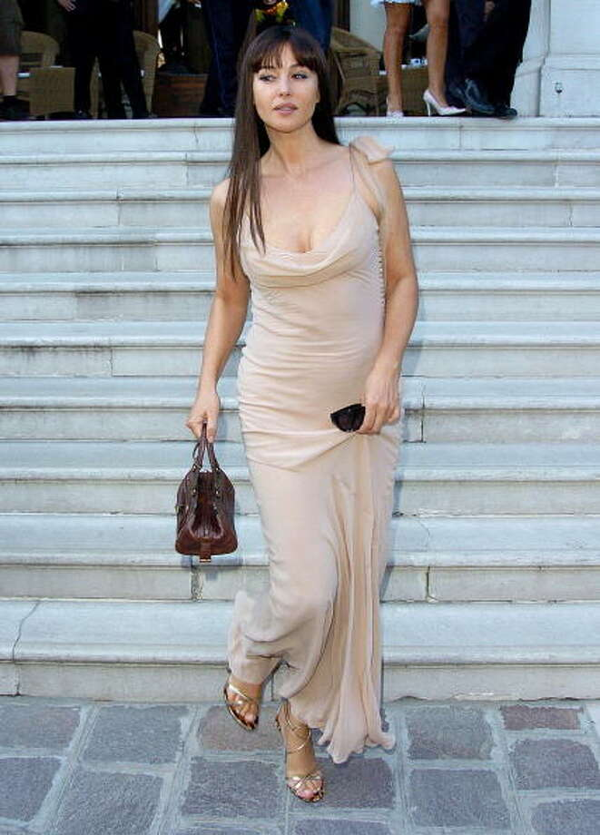 Monica Bellucci during 2005 Venice Film Festival - Sightings at Des Bain Hotel at Des Bain Hotel in Venice, Italy. Before the hotel's closure, the quarter-mile between the hotel and the festival grounds was a familiar spot to see movie stars.  It was too close to drive, so they walked. Photo: Niki Nikolova, FilmMagic