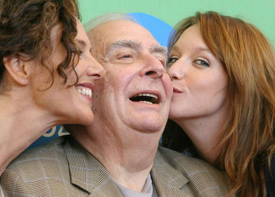 "Italian actress Valeria Cavalli, French director Claude Chabrol and French actress Ludivine Sagnier pose during a photocall for the movie ""La fille coupée en deux"" at Venice Lido 02 September 2007. Photo: ALBERTO PIZZOLI, AFP/Getty Images"