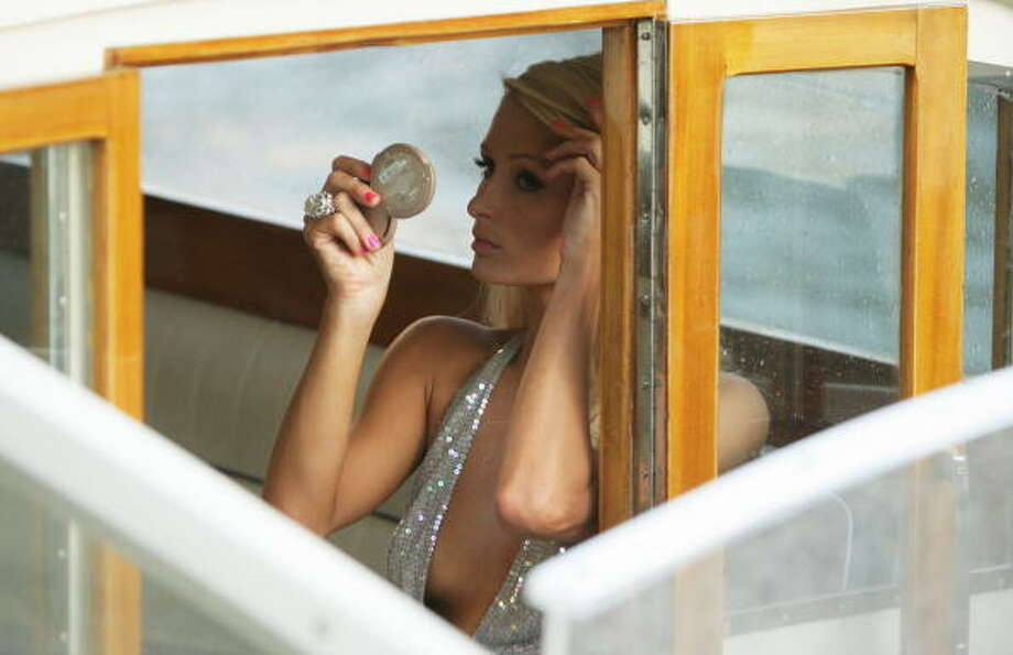 Paris Hilton looks at her make up on a water taxi during the 66th Venice Film Festival on September 4, 2009. Photo: Dan Kitwood, Getty Images