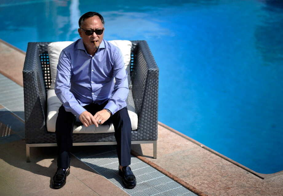 """Johnnie To from the film """"Duo Mingjin"""" poses for a portrait during the 68th Venice Film Festival at Nastro Azzuro on September 10, 2011 in Venice, Italy.  (Photo by Gareth Cattermole/Getty Images) Photo: Gareth Cattermole, Getty Images / 2011 Getty Images"""