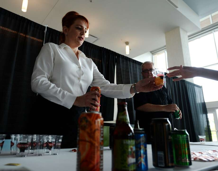 Shannon McGee pours a sample of Shocktop for a guest Thursday afternoon. The Jazz at the Lake concert series kicked off at the Event Centre Thursday night with Dean James and his band. There was also free food, beer tastings, and a cash bar for attendees of the free event. Photo taken Tuesday 7/29/14 Jake Daniels/@JakeD_in_SETX