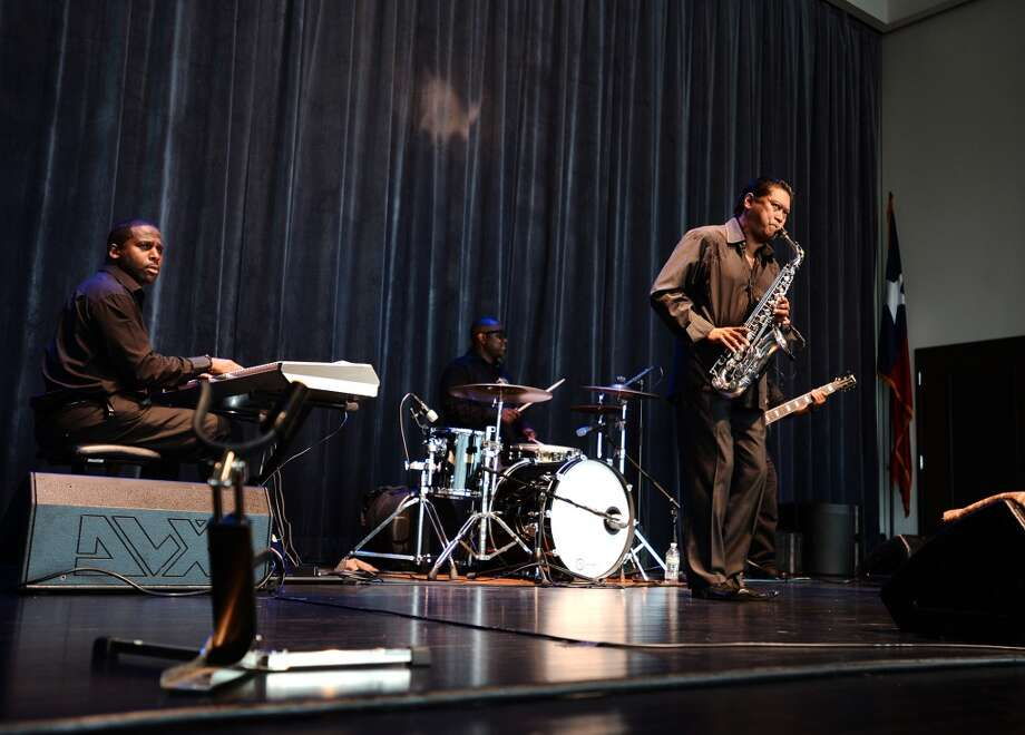 Dean James, right, and his band play during Jazz at the Lake on Thursday. The Jazz at the Lake concert series kicked off at the Event Centre Thursday night with Dean James and his band. There was also free food, beer tastings, and a cash bar for attendees of the free event. Photo taken Tuesday 7/29/14 Jake Daniels/@JakeD_in_SETX