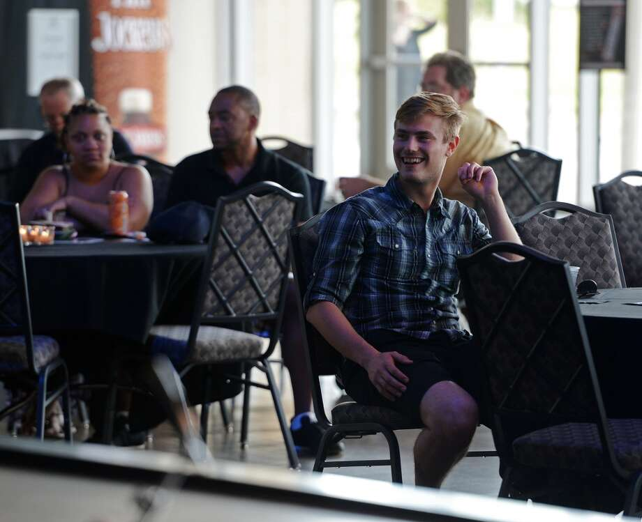 Matt Noble enjoys the jazz of Dean James during Thursday afternoon's concert. The Jazz at the Lake concert series kicked off at the Event Centre Thursday night with Dean James and his band. There was also free food, beer tastings, and a cash bar for attendees of the free event. Photo taken Tuesday 7/29/14 Jake Daniels/@JakeD_in_SETX