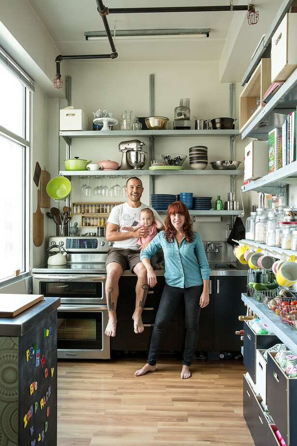 A 500-square-foot apartment for three Erin Feher Montoya, her husband, Danny Montoya, and 1-year-old daughter, Orion, in the kitchen of their Tenderloin apartment.