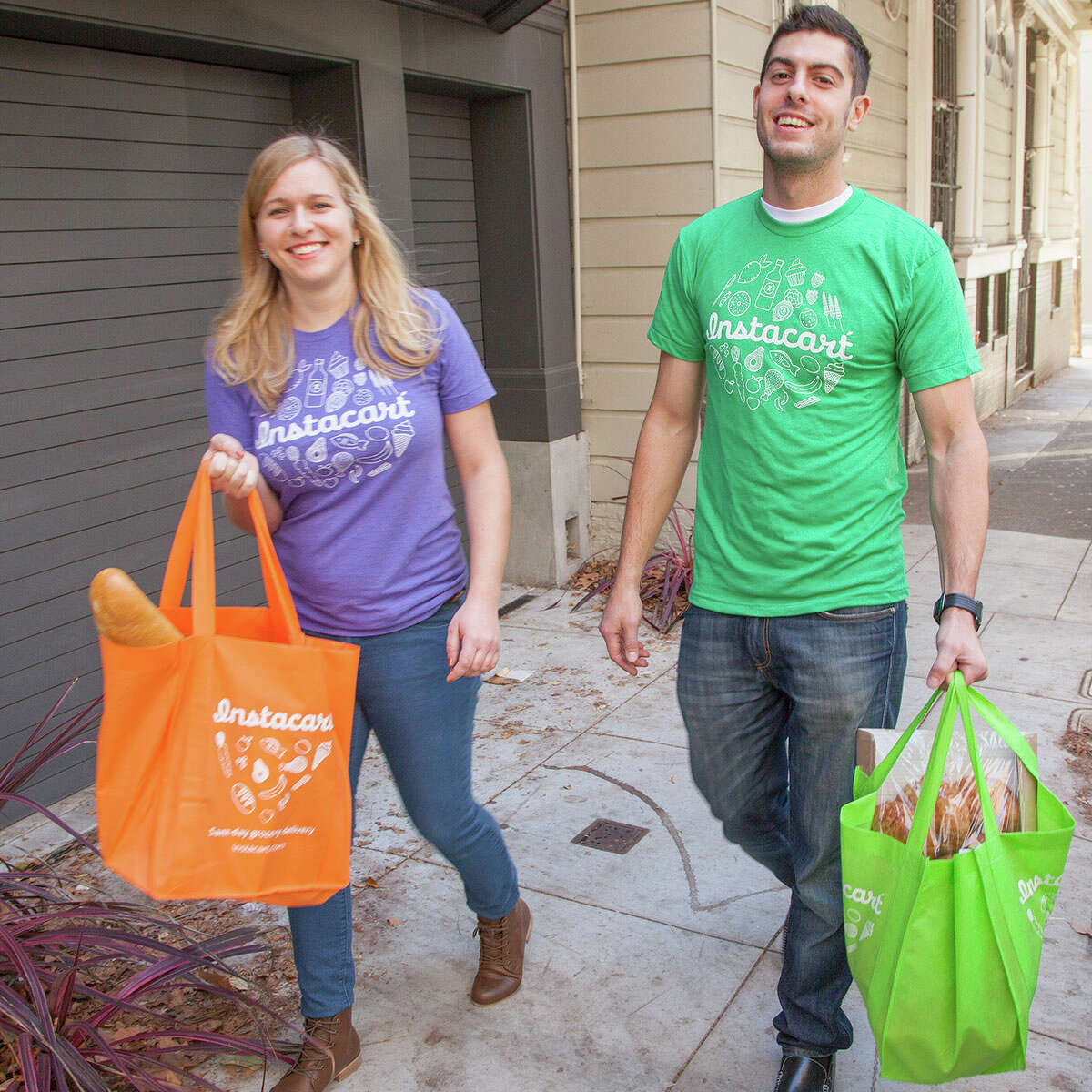 Instacart, a grocery delivery service, is launching in Houston on Wednesday. It will initially provide service for H-E-B and Whole Foods Market customers. Shown here are delivery personnel in the company's home city of San Francisco.
