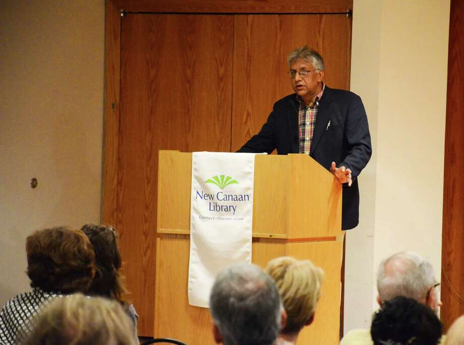 "Vijay Seshadri, winner of the 2014 Pulitzer Prize for poetry, speaks about his work at New Canaan Library in New Canaan, Conn., Thursday, Aug. 21, 2014. The author also performed readings from his fourth and latest collection of poetry, ""3 Sections."" Photo: Nelson Oliveira / New Canaan News"