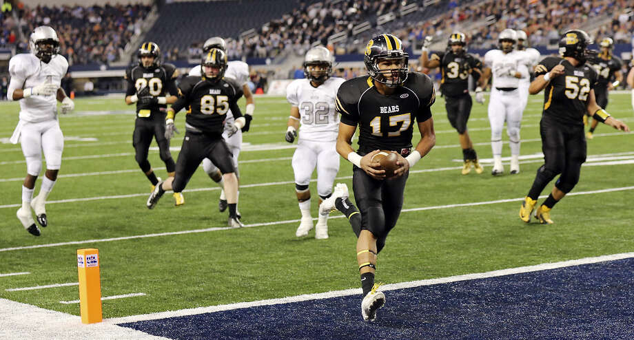 Brennan quarterback Da'Shawn Key, scoring a TD in last year's state title game against Denton Guyer, has transformed into a poised leader in just a few seasons. Photo: Edward A. Ornelas / San Antonio Express-News / © 2013 San Antonio Express-News