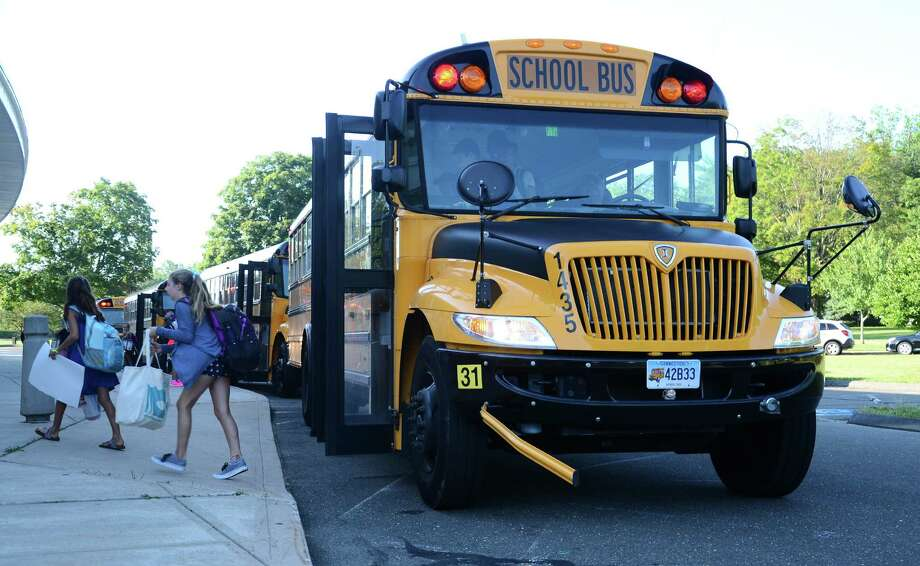 A school bus drops off kids at Saxe Middle School in New Canaan, Conn., on the first day of school Wednesday, Aug. 27, 2014. Photo: Nelson Oliveira / New Canaan News