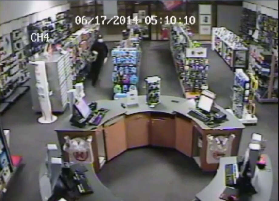 A surveillance video shows three men burlgarizing a store along U.S. 290 in northwest Harris County on June 30, 2014, officials said. | Crime Stoppers Photo: Crime Stoppers Of Houston