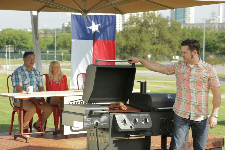 """American Grilleld"" host David Gaus reveals the surprise ingredients to contestants. Adrian Davila (left) of Davila's BBQ in Sequin is a guest on the Austin episode, which airs Aug. 27. (Courtesy photo)"