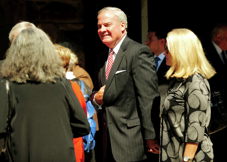 Former Governor John Rowland and wife Patty outside the funeral service for former Lieutenant Governor Joseph Fauliso at St. Peter Claver Church in West Hartford, Conn. on Tuesday, August 26, 2014. Photo: Brian A. Pounds / Connecticut Post