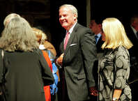 Former Governor John Rowland and wife Patty outside the funeral service for former Lieutenant Governor Joseph Fauliso at St. Peter Claver Church in West Hartford, Conn. on Tuesday, August 26, 2014.