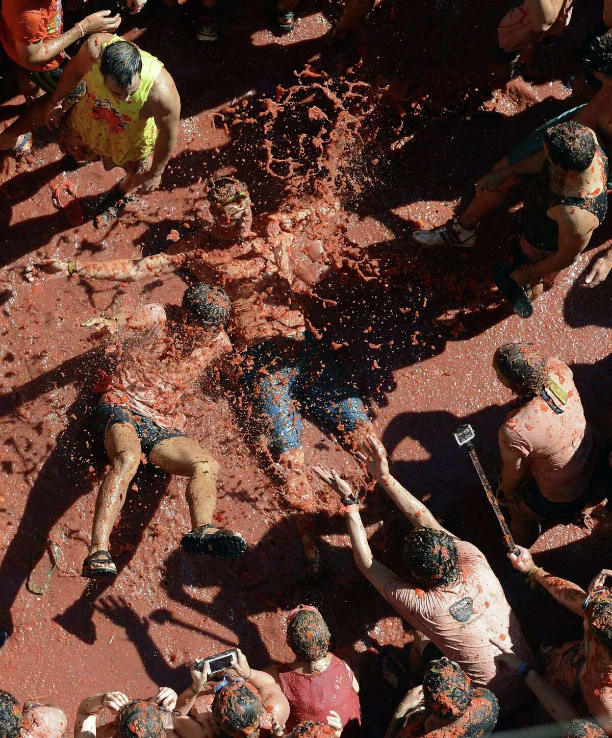 Revelers throw tomatoes while participating the annual La Tomatina festival on Wednesday, Aug. 27, 2014, in Bunol district of Valencia, Spain.