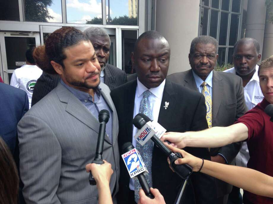 Robbie Tolan is pictured outside the courthouse Wednesday, Aug. 27, 2014. A federal magistrate Wednesday set a September 2015 trial date for Tolan's lawsuit against Bellaire police over a 2008 incident in which he was shot in his parent's driveway. Photo: Dane Schiller / Houston Chronicle