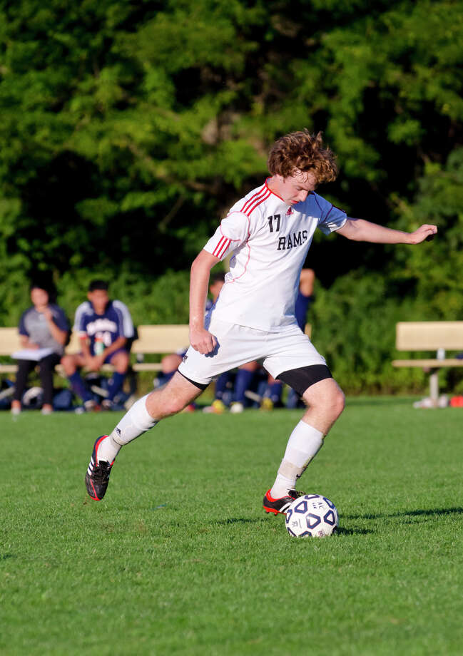 New Canaan's Alex Hutchins takes a shot against Brien McMahon during a boys soccer game at Conner Field in New Canaan on Tuesday, Oct. 1, 2013. Photo: Amy Mortensen / Connecticut Post Freelance