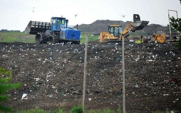 Tractors move solid waste at the Colonie Landfill last week. (Lori Van Buren/Times Union)