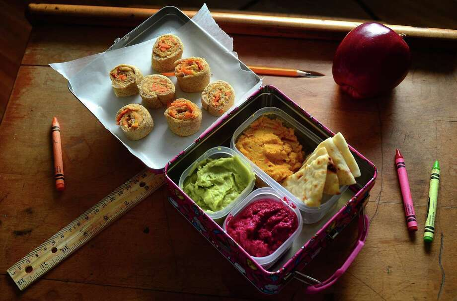 "There's something you can put in a kid's lunchbox that involves fresh vegetables, simple cooking techniques and it's trendy? Direct from the Middle East, hummus made with things besides chickpeas has suddenly become one of the hottest food trends around. Carrot hummus ""sushi"" rolls, and hummus made with carrots, avocado and beets are paired with pita wedges. (Todd Sumlin/Charlotte Observer/MCT) ORG XMIT: 1156372 Photo: TODD SUMLIN / Charlotte Observer"