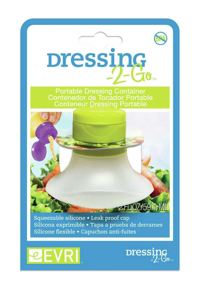 This image provided by Evriholder Products shows Dressing-2-Go. These tiny silicone squeeze bottles each one hold 2 ounces, perfect for salad dressings, ketchup, sour cream or anything else you might need to squeeze or squirt over a lunch. (AP Photo/Evriholder Products) ORG XMIT: MER2014081313032898 Photo: Uncredited / Evriholder Products LLC