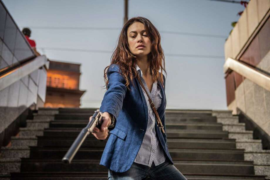 "This image released by Relativity Media shows Olga Kurylenko in a scene from the film, ""The November Man."" (AP Photo/Relativity Media, Aleksandar Letic) ORG XMIT: NYET706 Photo: Aleksandar Letic / Relativity Media"