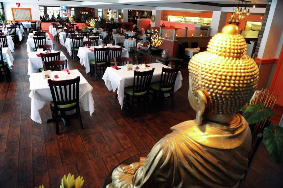 The dining room on Thursday, Feb. 13, 2014, at Orange Mango in Colonie, N.Y. (Cindy Schultz / Times Union) Photo: Cindy Schultz / 00025750A